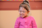 child with Down syndrome laughing